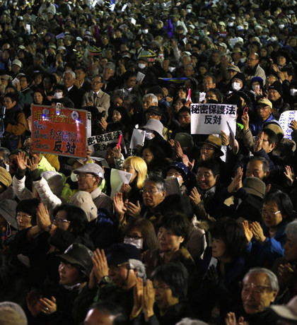 "Protesters hold placards reading ""Stop Secrecy Act"" during a rally against the government's planned secrecy law in Tokyo"