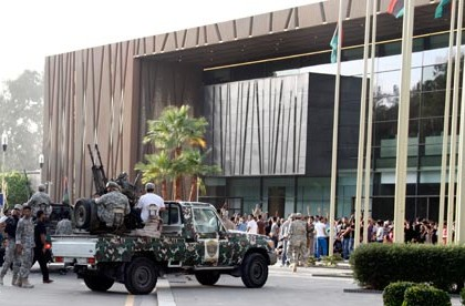 Libyan army vehicles converge on protesters in front of parliament in Tripoli