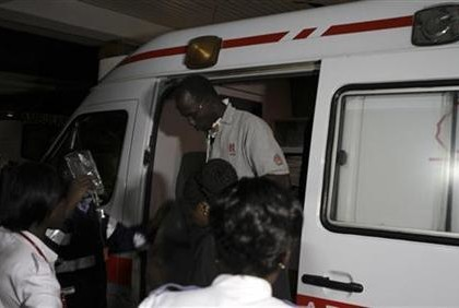 An unidentified MSF driver alights from an ambulance as he arrives at the Nairobi hospital in Kenya's capital Nairobi