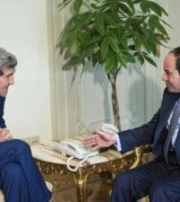 Egypt's President  al-Sisi and U.S. Secretary of State Kerry talk before a meeting at the Presidential Palace in Cairo